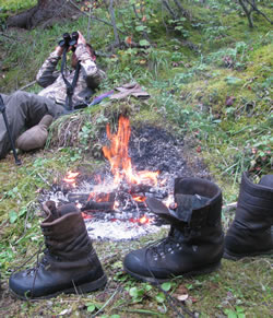 Drying Boots By The Fire