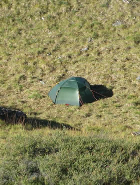 Tent in a high mountain pass.